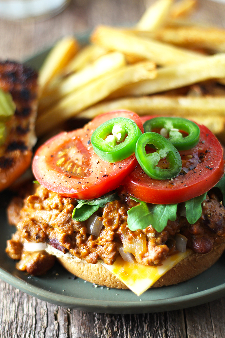 Slow Cooker Chili Cheese Sloppy Joes are an easy and unique twist on traditional sloppy joes. This recipe is extra saucy, exploding with flavor, and packed with melty cheese.
