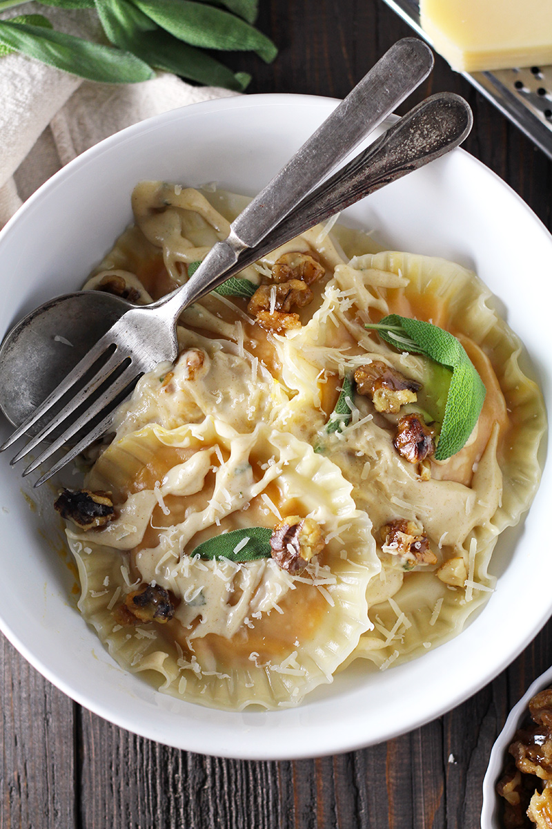 Butternut squash ravioli made super easy with wonton wrappers! Served with creamy and sweet brown butter sage sauce and homemade candied walnuts.
