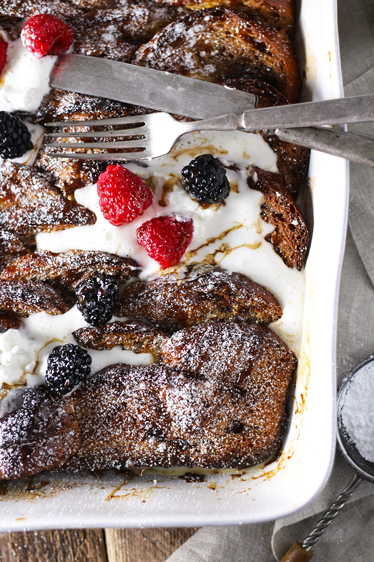 Hot Buttered Rum French Toast Bake is the coziest, tastiest breakfast bake that ever did exist. All the spices of a Hot Buttered Rum come together to create a delicious caramel sauce that bakes right into the French toast.