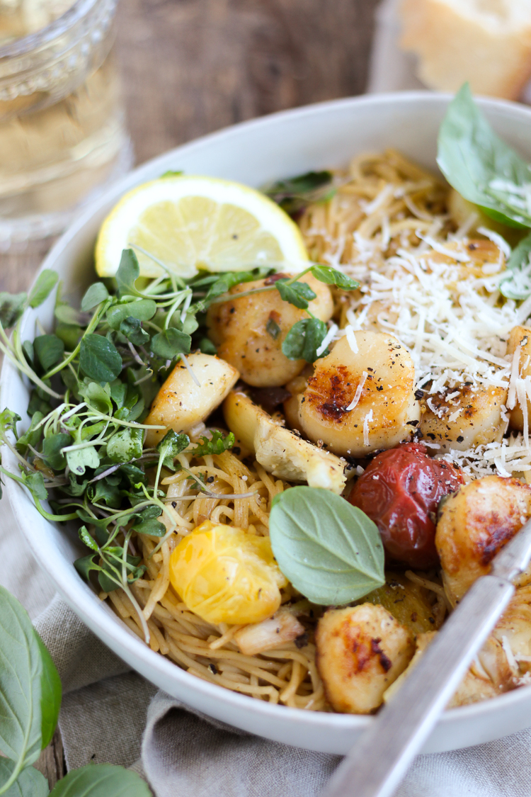 Scallops and artichokes seared in browned butter and tossed with pasta, burst tomatoes and fresh lemon for a light but comforting dinner that's ready in 30 minutes.