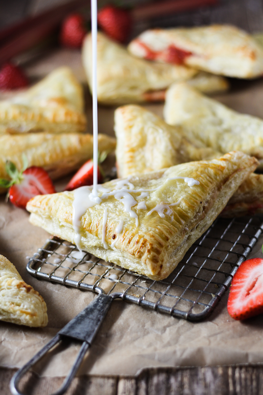 drizzling cream cheese glaze on turnovers