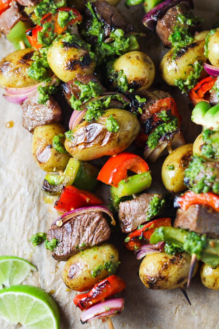 steak and potato kabobs drizzled with chimichurri sauce