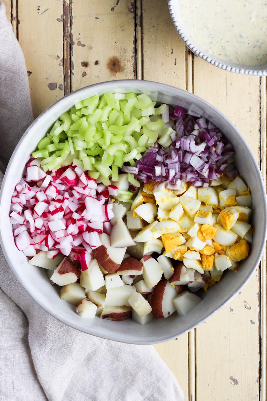 Potato salad ingredients in a bowl