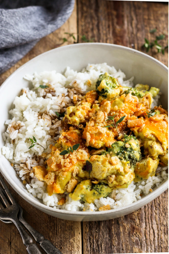 curry chicken and broccoli divan in a bowl over rice with soy sauce