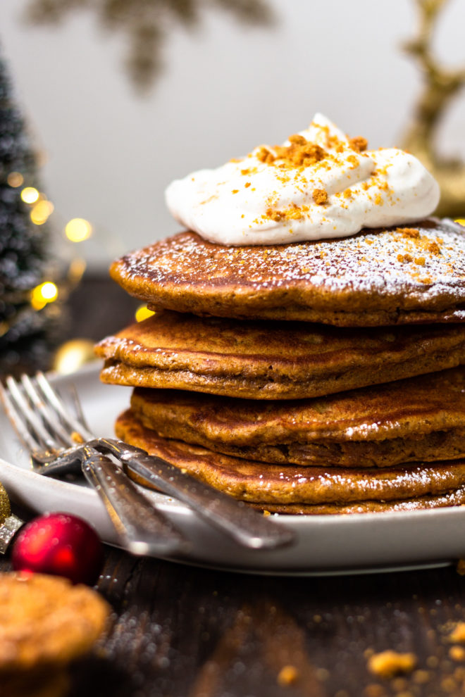 gingerbread pancakes with eggnog whipped cream and powdered sugar