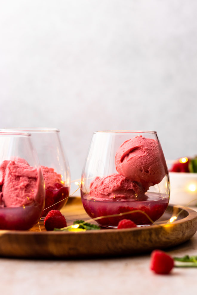 sherbet ice cream in a glass with raspberries