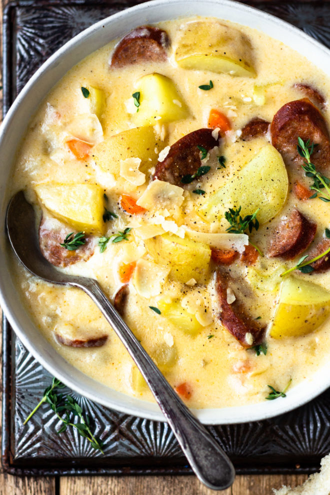 close up of smoked sausage and potato cheese soup
