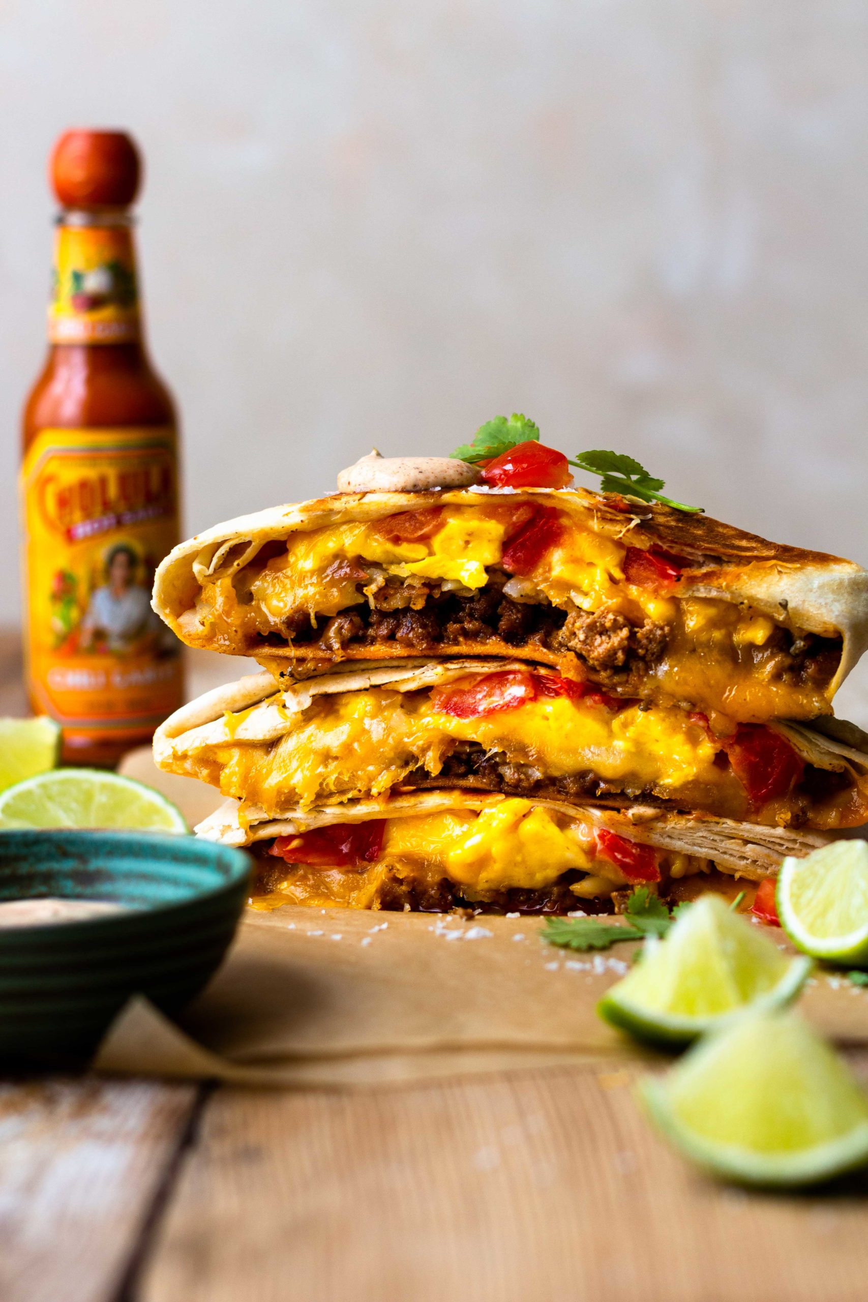 Flour tortilla stuffed with seasoned pork, crispy hash browns, fluffy scrambled eggs, lots of cheese, fresh tomatoes and the MOST delicious Creamy Jalapeño Sauce that tastes just like Taco Bell quesadilla sauce!! Grill the Breakfast Crunchwrap to melty, golden perfection then devour.