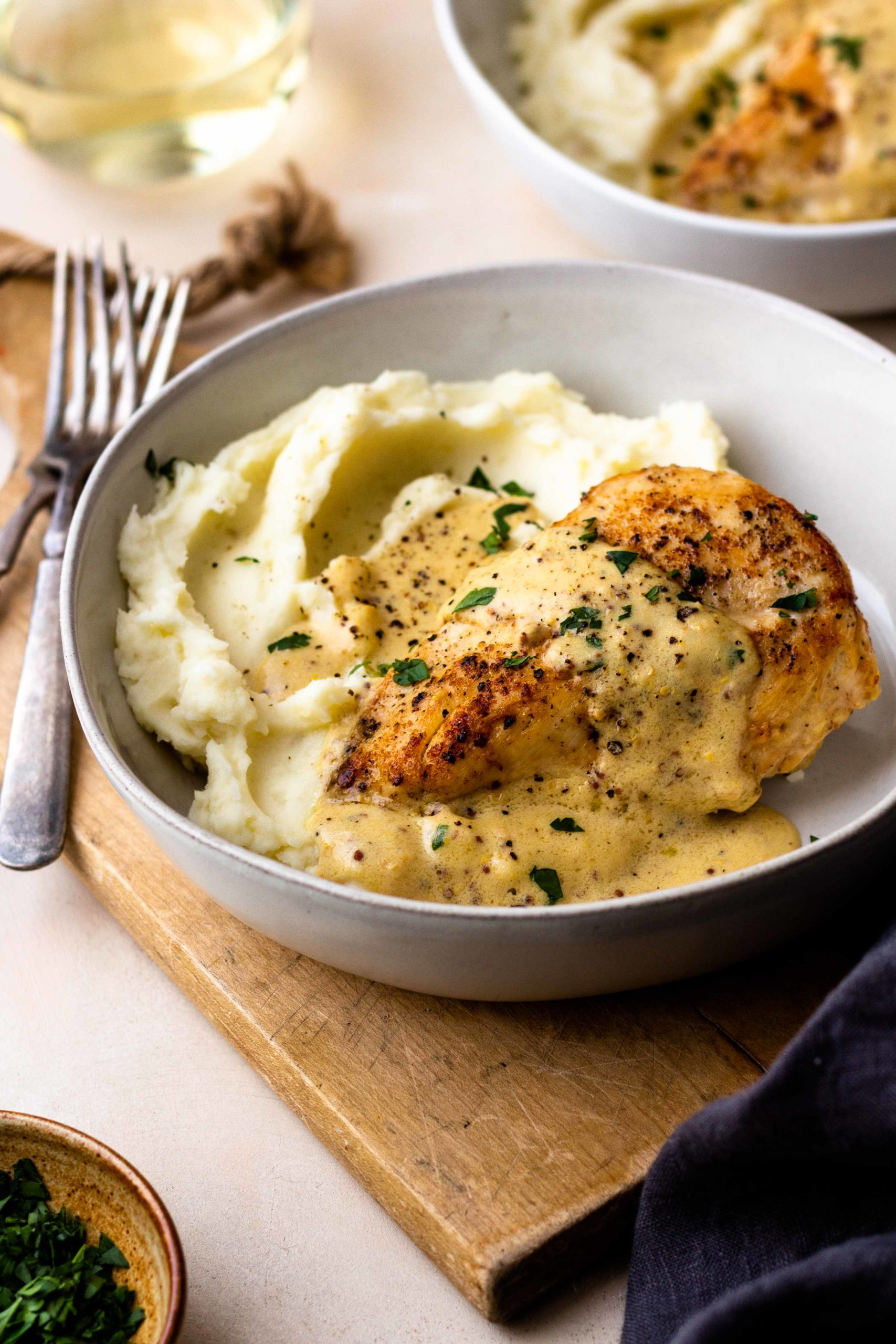 Tender and juicy chicken breasts smothered in the most insanely delicious dijon mustard cream sauce served over fluffy mashed potatoes. The chicken and sauce are all made in one skillet, making it an easy dinner. Perfect for date night or a casual weeknight night. Everyone will love this recipe!