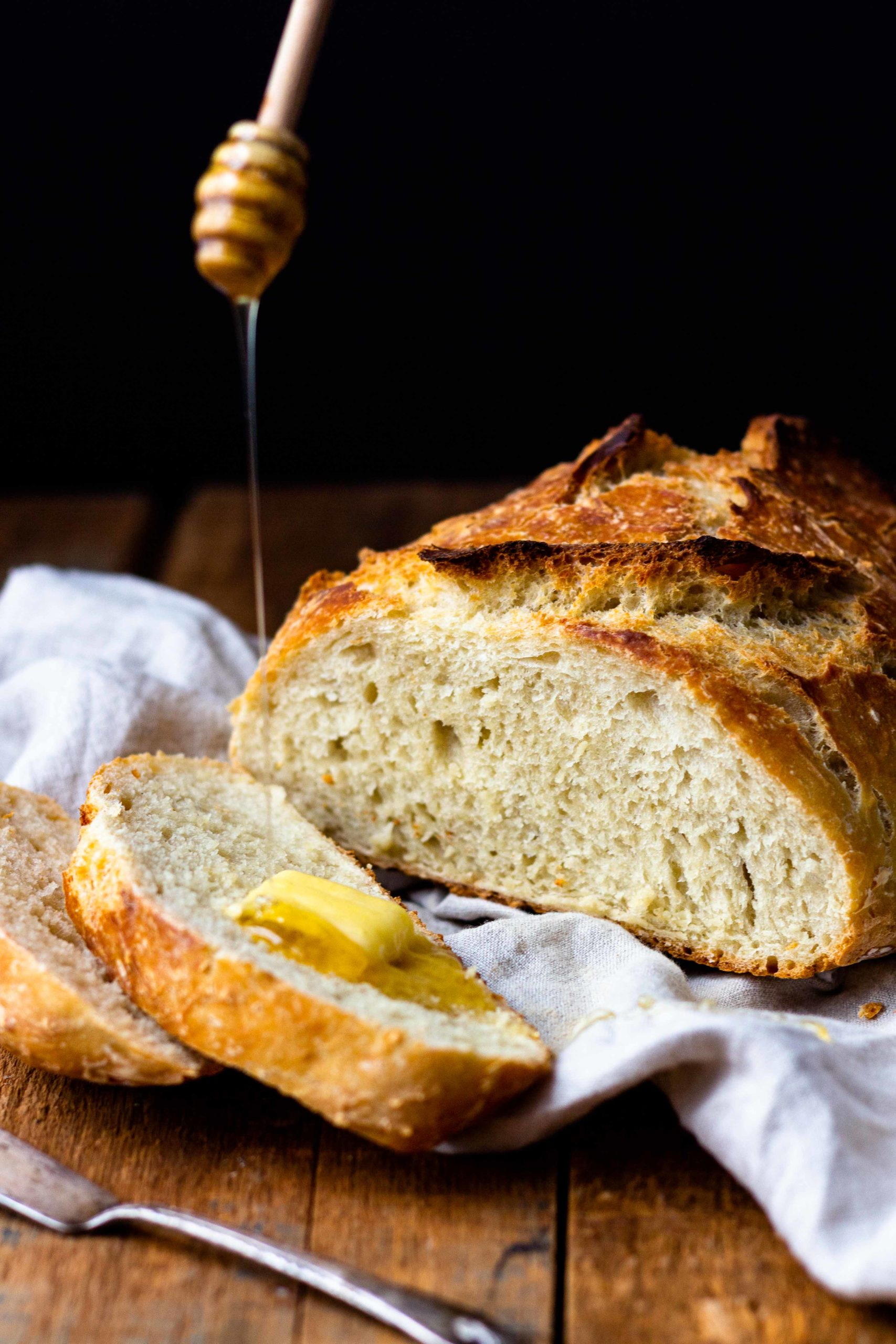 crusty bread with butter and honey