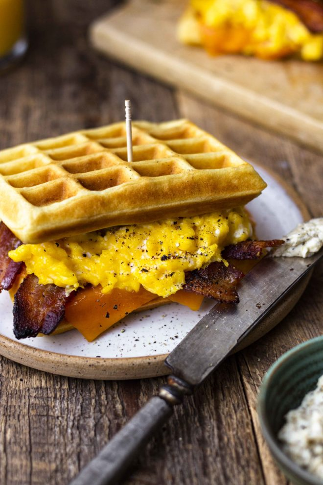 fluffy waffles with eggs, bacon and cheese sandwich