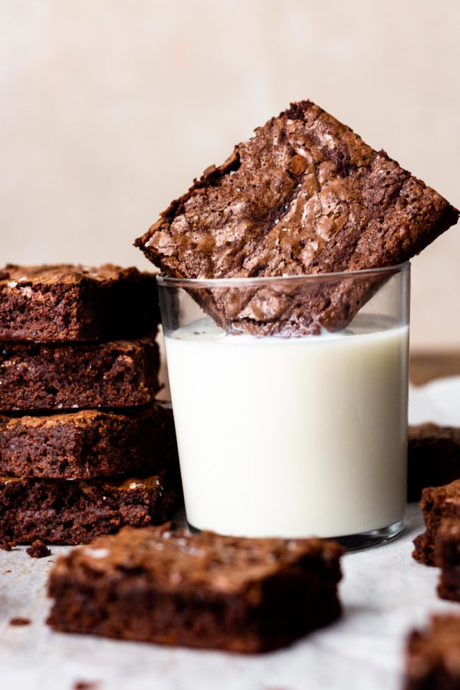 The brownies of your dreams! Thick, chewy, chocolatey, and extra fudgy, these brownies are super easy to make with ingredients you likely already have in your pantry. All you need is 10 minutes and one mixing bowl, then bake till fudgy, chewy perfection. They're even better than boxed brownies!