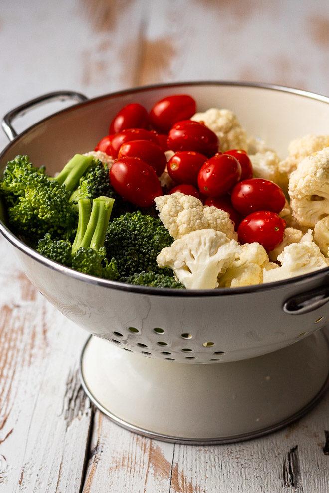 freshly washed broccoli, cauliflower and tomatoes