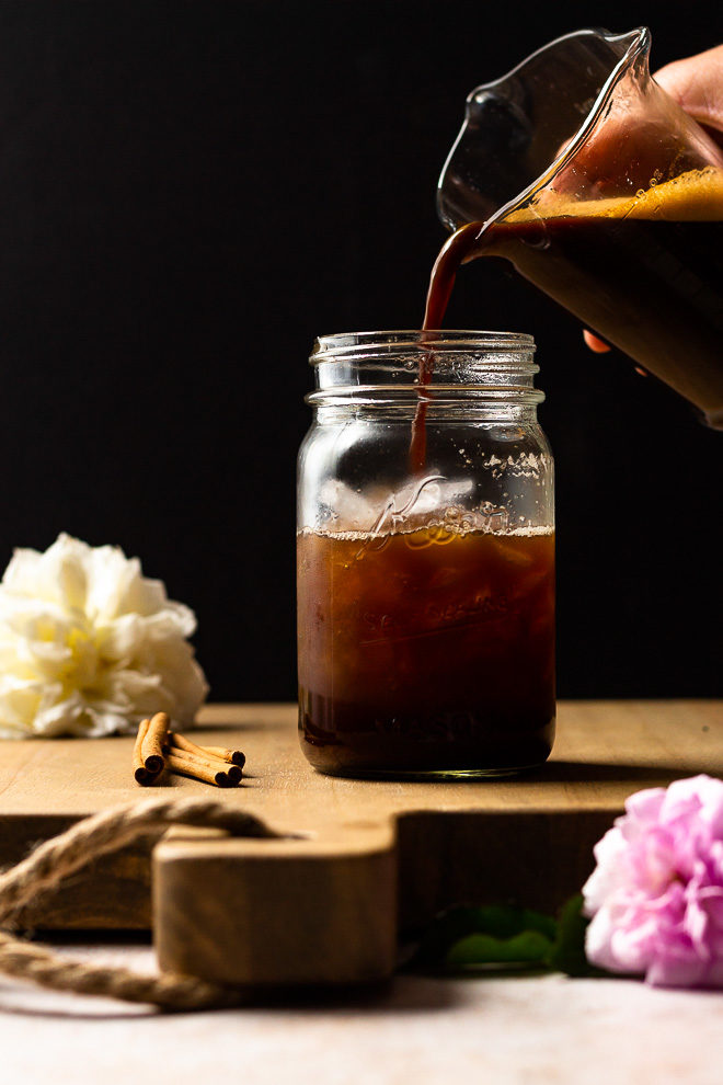 Pouring brown sugar syrup and espresso over ice