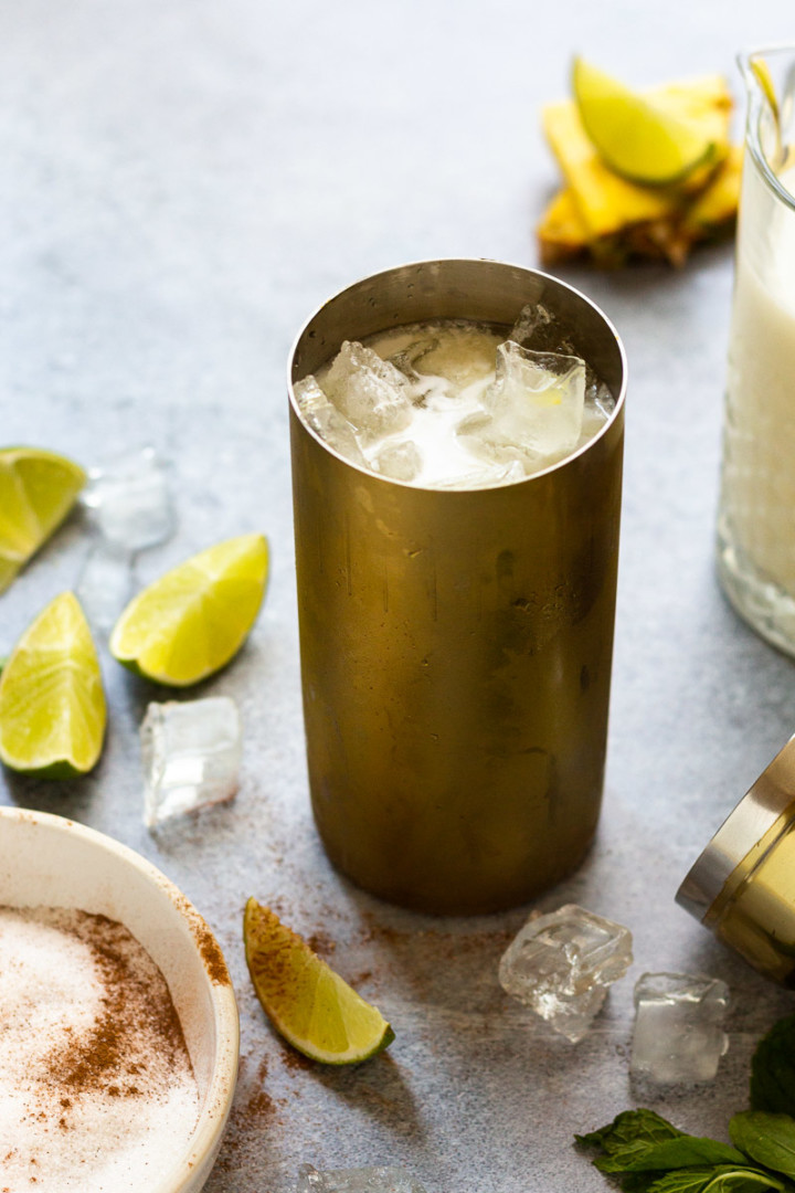 rum, pineapple juice, and coconut milk in a cocktail shaker