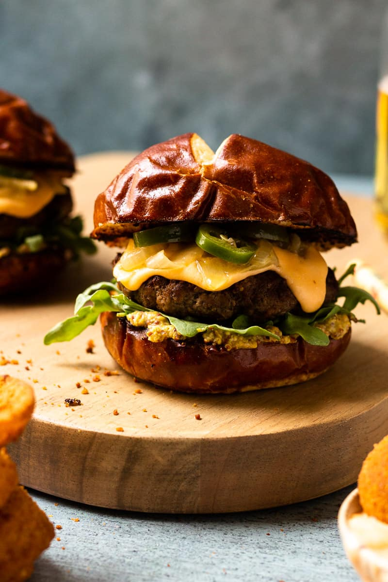 burger covered in beer cheese