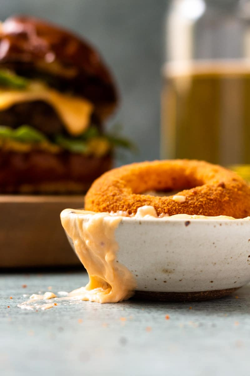 onion ring dipped in beer cheese