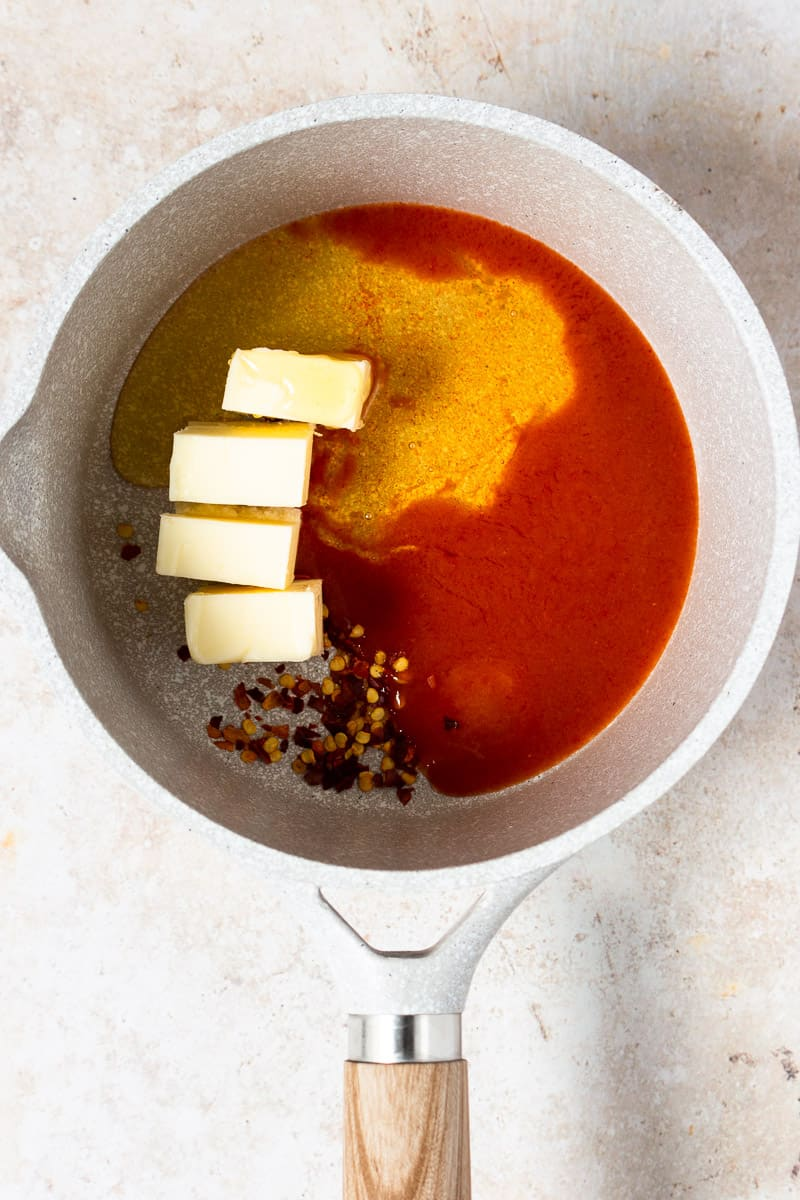 butter, honey, hot sauce, and red pepper flakes in a saucepan