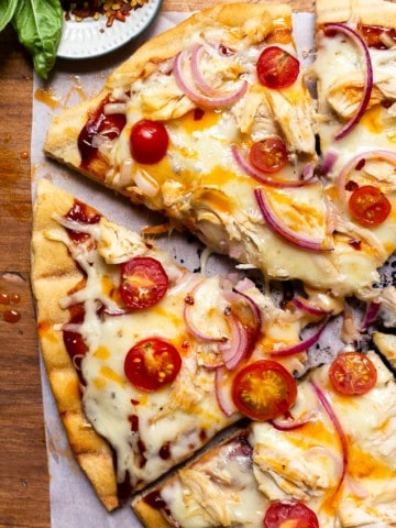 grilled pizza drizzled with hot honey butter